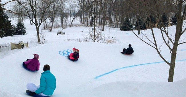 Families celebrate Olympics at backyard sled track