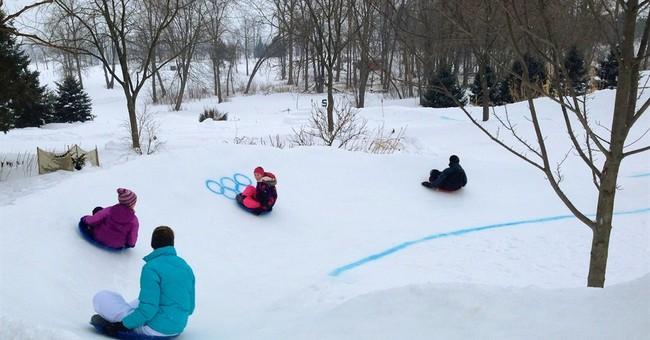 Families celebrate Olympics at backyard sled track