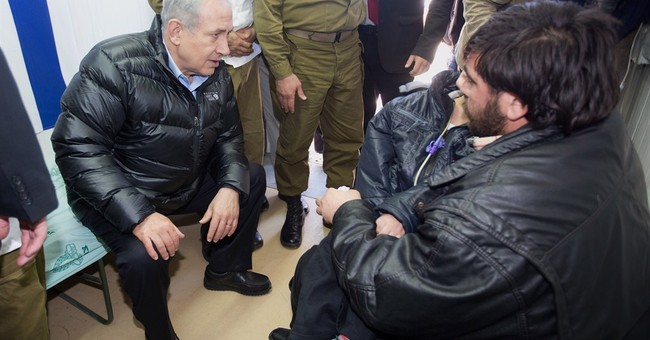 Israeli premier meets wounded Syrians, blames Iran