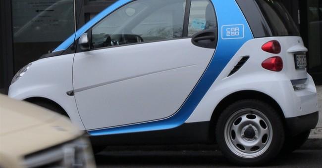 As German car sales drop, industry bets on sharing