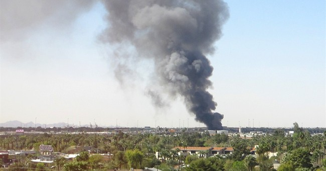 Fire sends tall plume of black smoke over Phoenix