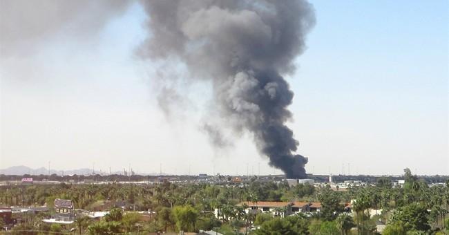 Fire sends tall plume of black smoke over Phoenix