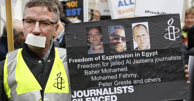 Al-Jazeera reporters go on trial in Egypt