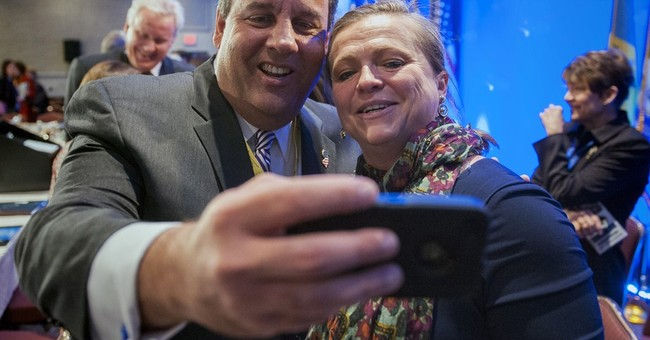NJ's Christie keeps low profile as Dems attack