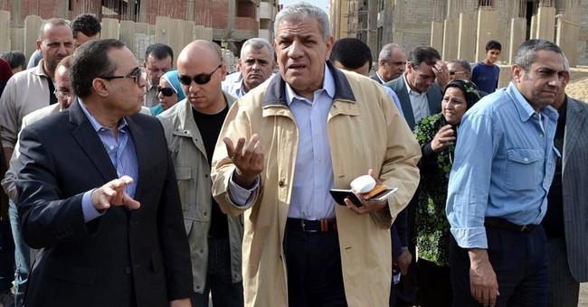 Egypt names new premier ahead of key vote
