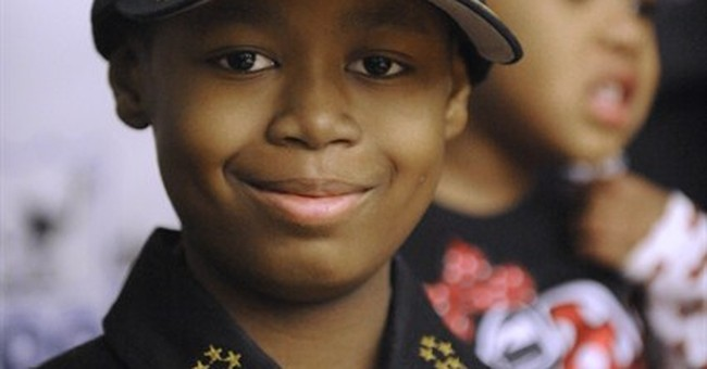 Boy, 9, who spent day as Detroit police chief dies