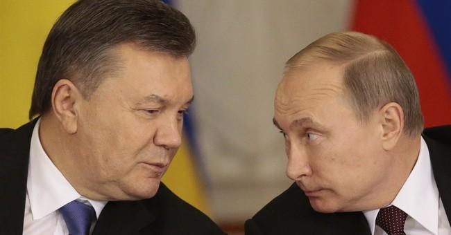 Putin: Russia to consider aid to Ukraine