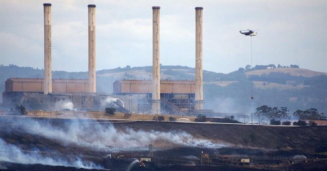 Australians advised to flee town near burning mine