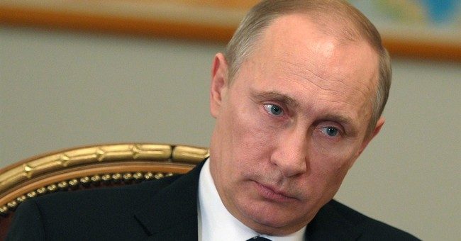 Putin defends Russian action in Ukraine to Merkel