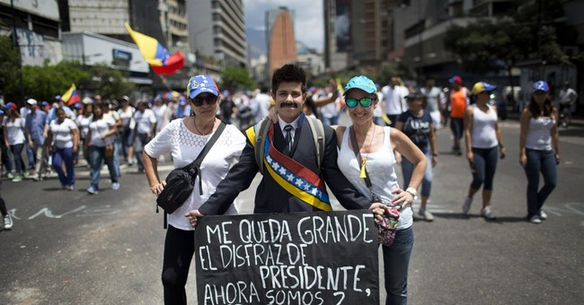 Venezuelan opposition marches to keep up momentum