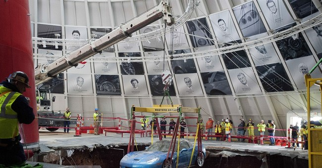First 2 Corvettes lifted by crane from Ky sinkhole