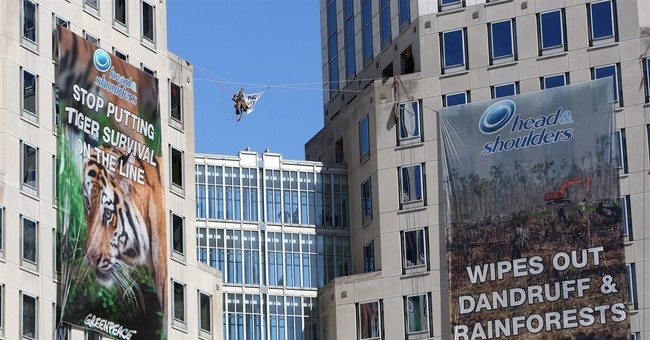 Greenpeace hangs protest banners at P&G HQ in Ohio