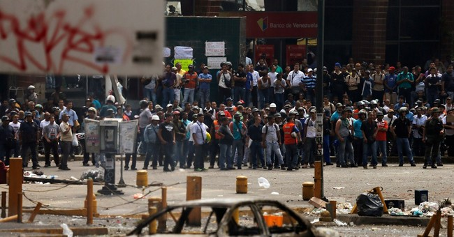2 dead as Venezuelans clash at protest barricades