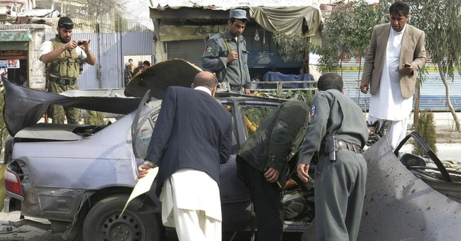 Bomb planted under car seat kills Afghan official