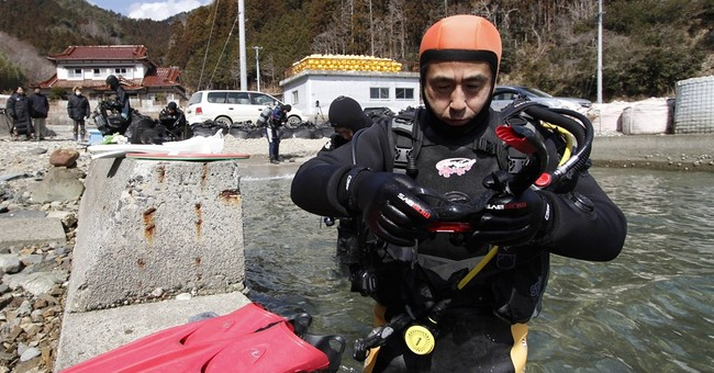 Man learns diving to look for wife lost in tsunami
