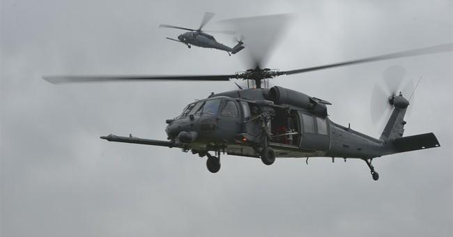 UK: investigators study scene after copter crash