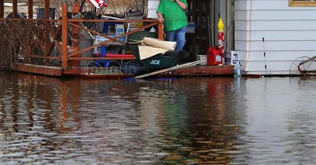 Crews assess flood damage in Montana, Wyoming