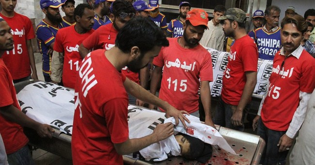 Gunmen kill 14 people in attack in Pakistan