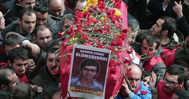 Turkish police, crowds clash after teen's funeral