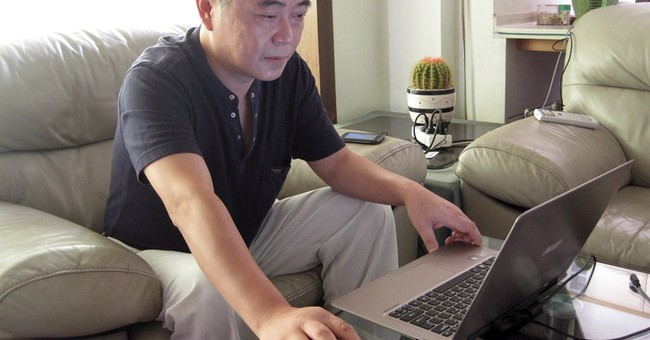 Chinese police seize activist who runs rights site
