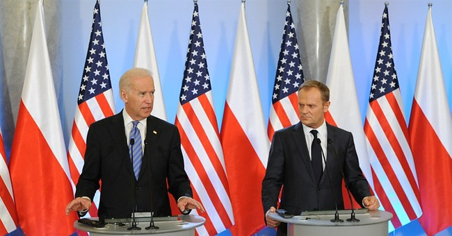 Pushing back on Russia, Biden vows more sanctions