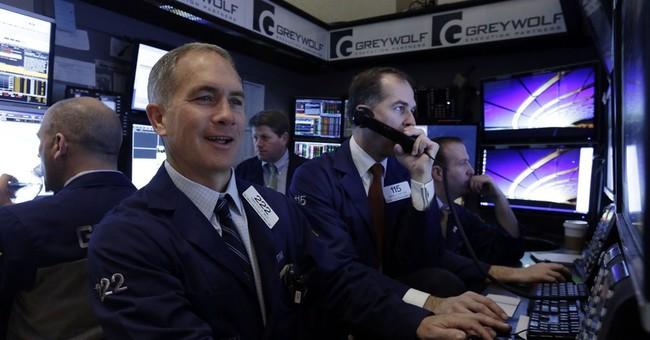 Stocks slip ahead of Fed decision; Oracle falls