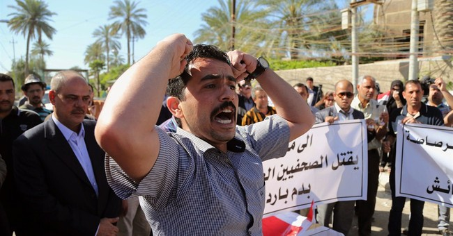Iraq papers protest killing of well-known reporter