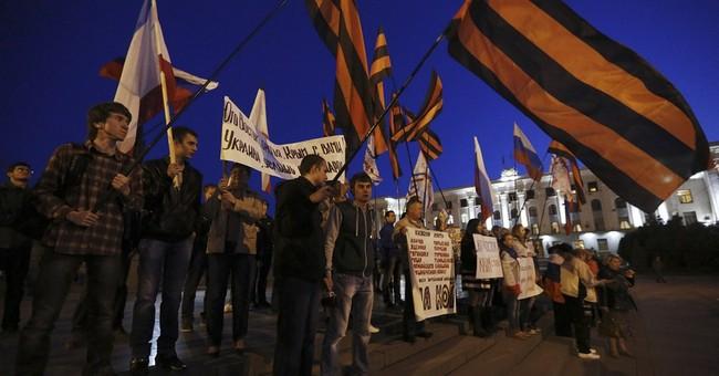Reid slams GOP over Crimea; Senate bill advances