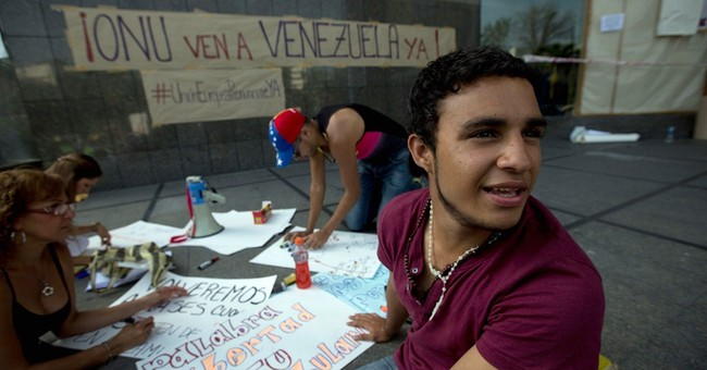 Venezuelan protesters camp outside UN office