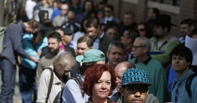 Applications for US jobless aid dip to 4-month low