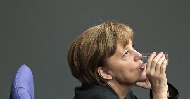 Merkel: Russia should help ease Ukraine crisis