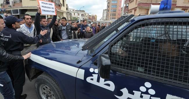 Protesters heckle Algeria president's campaign