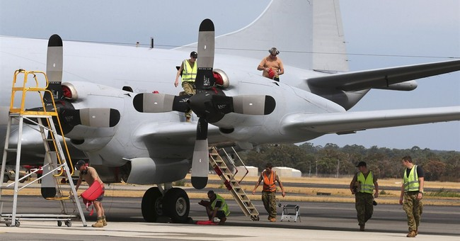 Ground crew work nights to keep MH370 search aloft
