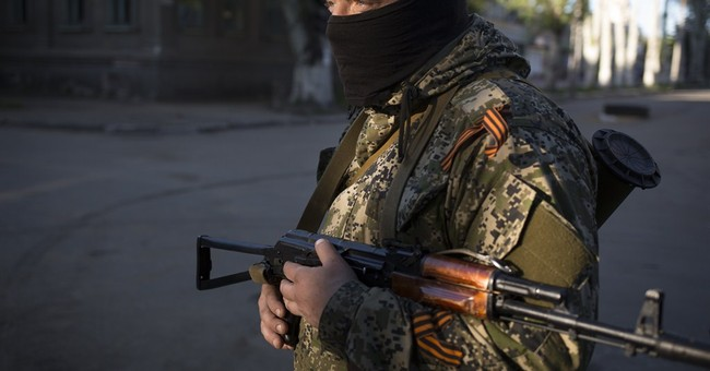 Russia Watches as Ukraine Falls Apart