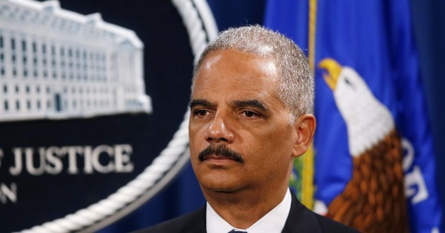 Holder Accuses Obama Opponents of Being Racist Again