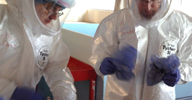 Additional Ebola Screening Measures Implemented at Airports: Taking Temperatures