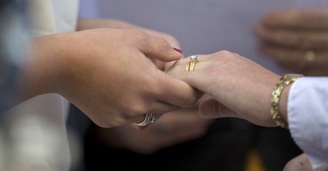 Same-Sex Marriage Decisions: The Constitution Protects Gays But Not Blacks and Women