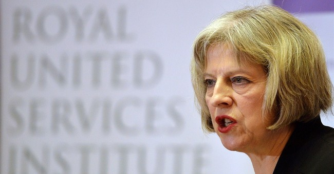 May Criticises Trump's Protest Response