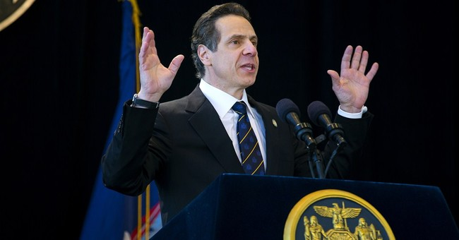 Cuomo begins 2nd term on day his father dies