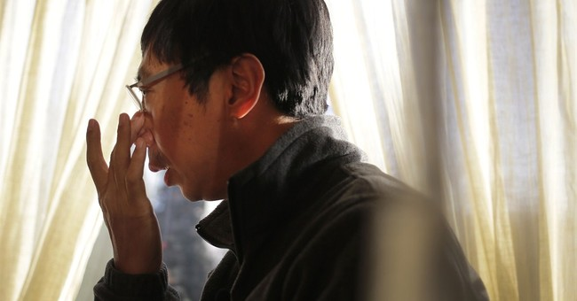 MH370 relatives view Indonesia crash with empathy, and envy