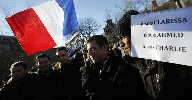 Hundreds in NYC gather in solidarity after French attacks