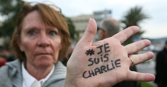 France hunts suspect, prepares for mass anti-terrorism rally