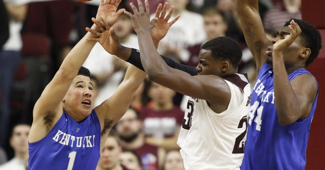 Top-ranked Kentucky beats A&M 70-64 in double OT