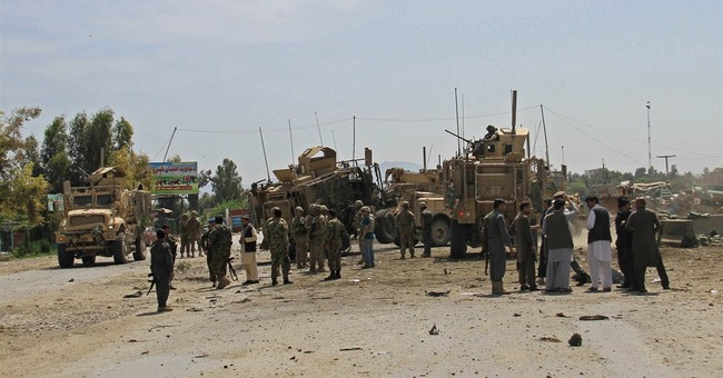 Bombings, including attack on US troops, kill 13 Afghans