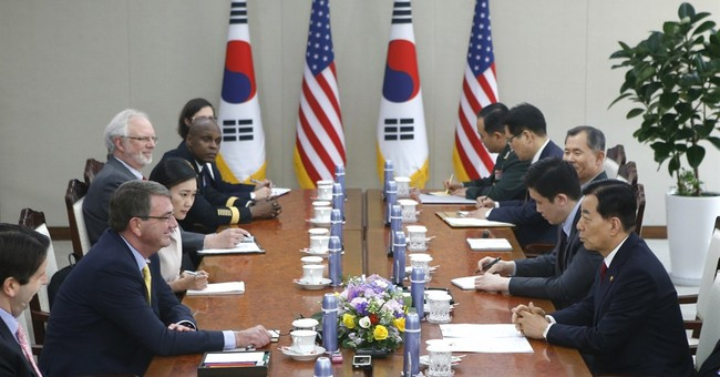 Carter chides China over approach to territorial disputes