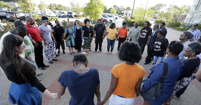 Black motorist's fatal shooting: Outcry over police tactics