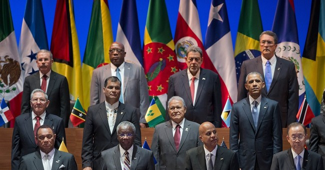 Latest on Americas Summit: Obama misses out on group photo