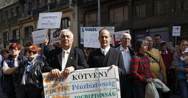 Hungarian investors want full reparation as brokerage falls