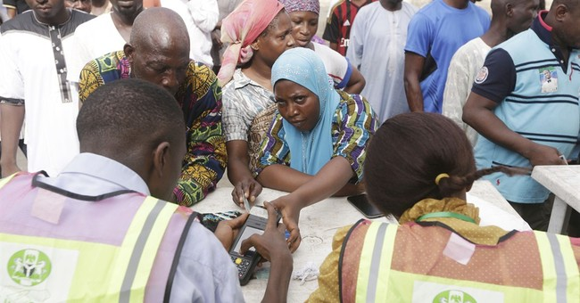 Nigerians vote for state governors, 9 killed in south
