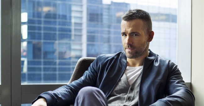 Actor Ryan Reynolds hit, not injured, by car in Vancouver